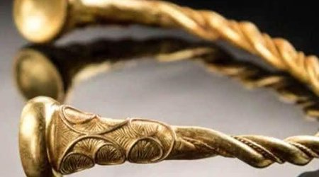 UK Treasure Hunters Unearth Four Golden Torcs Dating Back 2,500 Years